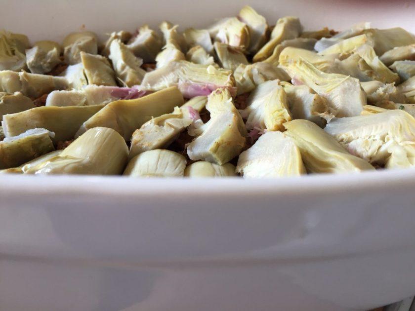 arrange the artichoke slices